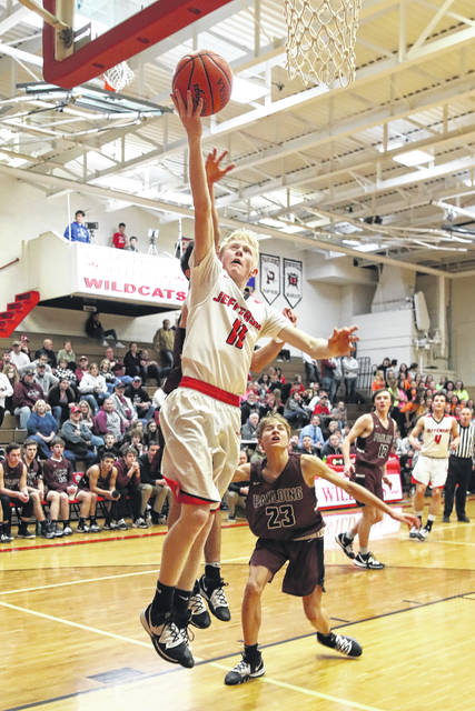 Delphos Jefferson's Damon Wiltsie puts up a shot during Friday night's game against Paulding in Delphos.