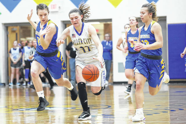 Continental's Katie Keller, left, and Alex Hoeffel pursue Miller City's Abi Lammers during Friday night's game at Miller City.