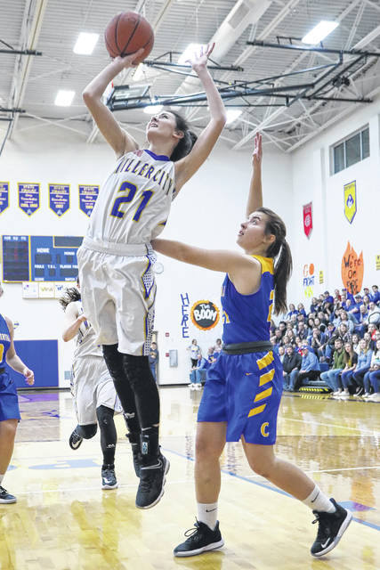 Miller City's Abi Teders puts up a shot against Continental's Kerri Prowant during Friday night's game at Miller City.