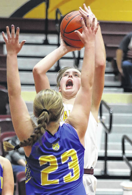 Kalida's Grace Klausing puts up a shot against Miller City's Natalie Koenig during Saturday's game at Kalida.