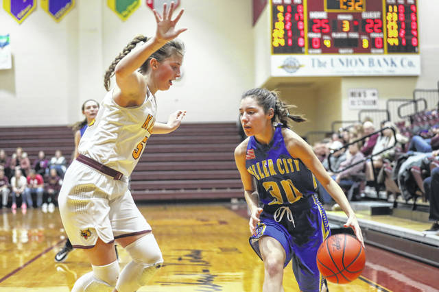 Kalida's Grace Klausing guards Miller City's Abi Reyna during Saturday's game at Kalida.