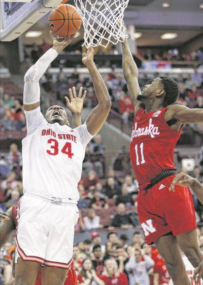 Ohio State's Kaleb Wesson puts up a shot against Nebraska's Dachon Burke during Tuesday night's game in Columbus.