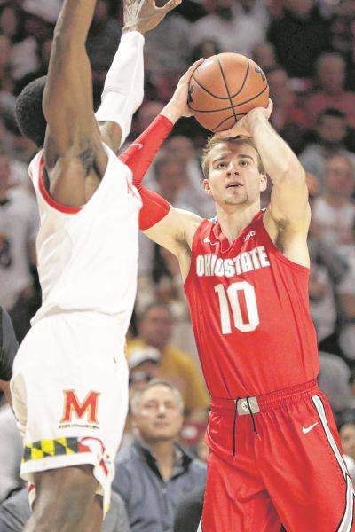 Ohio State's Justin Ahrens (10), a Versailles graduate, puts up a shot against Maryland's Darryl Morsell during Tuesday night's game in College Park, Md.