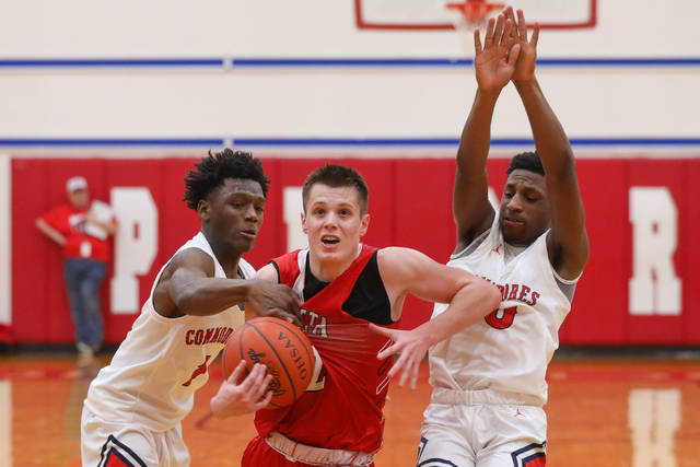 "Defense has been a major factor in Perry's success as they demonstrate here against Wapakoneta Terry Riley (1) , shown here has spearheaded the defense and Perry's Brayden ""Bubby"" Knight (0) has emerged as a key member of the Commdores' offense."
