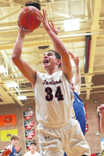 Shawnee's Tyson Elwer puts up a shot during Saturday night's home game against Delphos St. John's.
