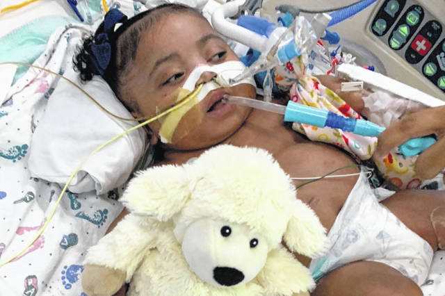 This Nov. 8, 2019 photo provided by Texas Right to Life shows Tinslee Lewis. On Thursday, Jan. 2, 2020, a Texas judge sided with a hospital that plans to remove the 11-month-old girl from life support after her mother disagreed with the decision by doctors who say the infant is in pain and that her condition will never improve.