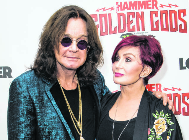Ozzy Osbourne, left, and his wife Sharon Osbourne appear in 2018 in London. The 71-year-old Grammy winner and former vocalist for the metal band Black Sabbath cancelled his North American farewell tour dates, in light of his planned treatment for Parkinson's disease.