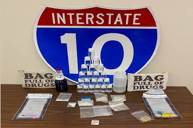 In this photo made available by the Florida Highway patrol shows confiscated drugs following the arrest of two men Tuesday, Feb. 4, 2020, Santa Rosa County, Fla. Authorities confiscated methamphetamine, cocaine and fentanyl. (Florida Highway Patrol via AP)