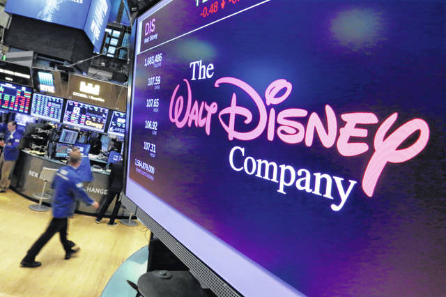 The Walt Disney Co. said Tuesday that profit fell 23% in its latest quarter to $2.13 billion as it absorbed losses, and a big revenue boost, from its new streaming service, Disney Plus.