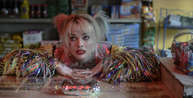 """This image released by Warner Bros. Pictures shows Margot Robbie in a scene from """"Birds of Prey."""" (Claudette Barius/Warner Bros. Pictures via AP)"""