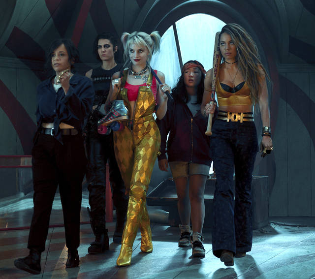 """This image released by Warner Bros. Pictures shows, from left, Rosie Perez, Mary Elizabeth Winstead, Margot Robbie, Ella Jay Basco and Jurnee Smollett-Bell in a scene from """"Birds of Prey."""" (Claudette Barius/Warner Bros. Pictures via AP)"""