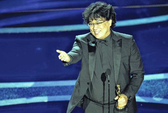 "Bong Joon Ho accepts the award for best director for ""Parasite"" at the Oscars on Sunday at the Dolby Theatre in Los Angeles."