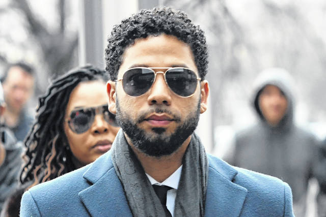 Empire actor Jussie Smollett arrives in March 2019 at the Leighton Criminal Court Building for a hearing in Chicago. Smollett faces new charges for reporting an attack that Chicago authorities contend was staged to garner publicity.