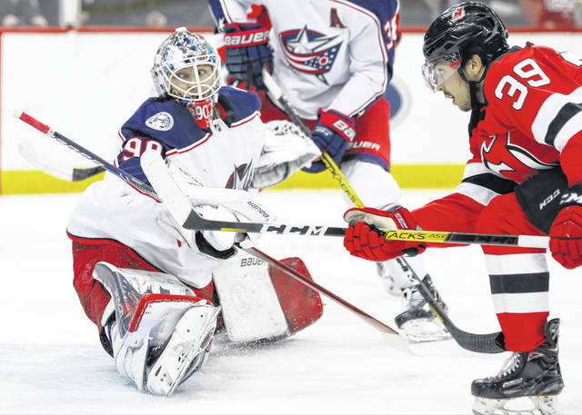 New Jersey Devils right wing Nicholas Merkley (39) watches as his shot goes past Columbus Blue Jackets goaltender Elvis Merzlikins (90) for a goal during the second period of an NHL hockey game Sunday, Feb. 16, 2020, in Newark, N.J. (AP Photo/Kathy Willens)