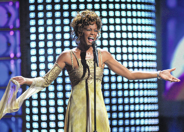 "FILE - In this Sept. 15, 2004 file photo, recording artist Whitney Houston performs at the 2004 World Music Awards at the Thomas and Mack Arena in Las Vegas. Houston is about to appear on the concert stage again. Eight years after her death, five years after the show was conceived and a year after production began, a holographic Houston will embark on a European tour starting Feb. 25, with U.S. dates expected to follow. The singer's sister-in-law and former manager Pat Houston says it's the right time for a revival, and says it's a show Whitney Houston would've wanted. The concerts will feature a projected Houston performing most of her biggest hits, including ""I Will Always Love You,"" with real backup dancers and a live band. (AP Photo/Eric Jamison, file)"