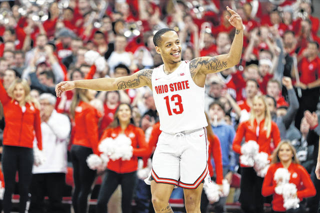 Ohio State's C.J. Walker celebrates a win over Maryland in an NCAA college basketball game Sunday, Feb. 23, 2020, in Columbus, Ohio. (AP Photo/Jay LaPrete)