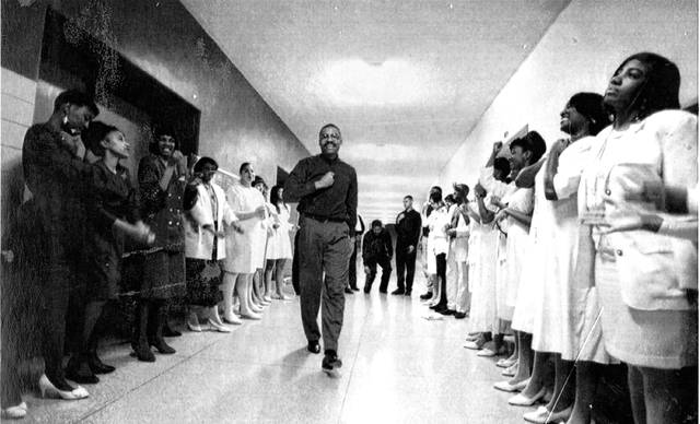 The Rev. B. LaMont Monford strides in through a crowd of people in this photo from April 1995.