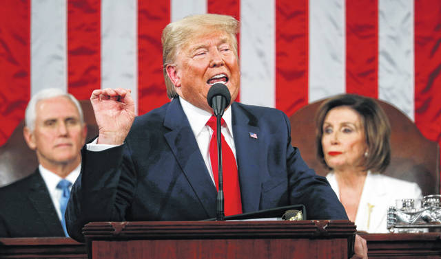 President Donald Trump delivers his State of the Union address to a joint session of Congress in the House Chamber on Capitol Hill in Washington, Tuesday, Feb. 4, 2020, as Vice President Mike Pence and Speaker Nancy Pelosi look on.