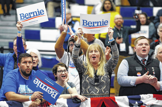 Supporters of Democratic presidential candidate Sen. Bernie Sanders, I-Vt., cheer as the polls close at a primary night election rally in Manchester, N.H., Tuesday, Feb. 11, 2020.