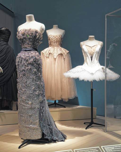 """This photo provided by The Museum at FIT shows a Christian Dior, """"Debussy"""" evening gown worn by ballerina Margot Fonteyn in the spring/summer 1950; Cristobal Balenciaga for Hattie Carnegie, pink silk tulle and satin evening dress with silver metal embroidery; Marc Happel, """"Symphony in C"""" costume, 2012, that are part of the new exhibit at the Fashion Institute of Technology in New York. The exhibit features 90 items, including ballet costumes, high fashion and athletic wear."""