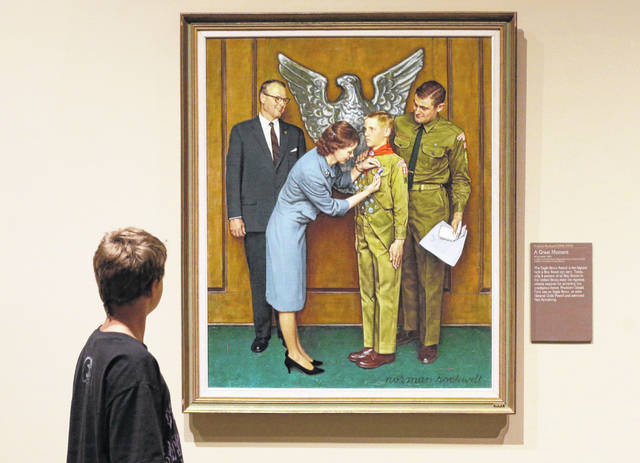 FILE - This July 22, 2013, file photo shows one of the twenty-three original, Boy Scout-themed Norman Rockwell paintings during an exhibition at the Church History Museum in Salt Lake City, Utah. The Boy Scouts of America has filed for bankruptcy protection as it faces a barrage of new sex-abuse lawsuits. The filing Tuesday, Feb. 18, 2020, in Wilmington, Del., is an attempt to work out a potentially mammoth compensation plan for abuse victims that will allow the 110-year-old organization to carry on.