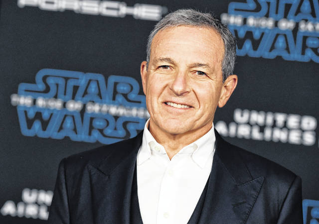 """FILE - In this Dec. 16, 2019, file photo, Disney CEO Robert Iger arrives at the world premiere of """"Star Wars: The Rise of Skywalker"""", in Los Angeles The Walt Disney Co. has named Bob Chapek CEO, replacing Bob Iger, effective immediately, the company announced Tuesday, Feb. 25, 2020."""