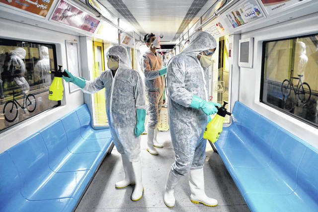 Workers disinfect subway trains against coronavirus in Tehran, Iran, in the early morning of Wednesday, Feb. 26, 2020.
