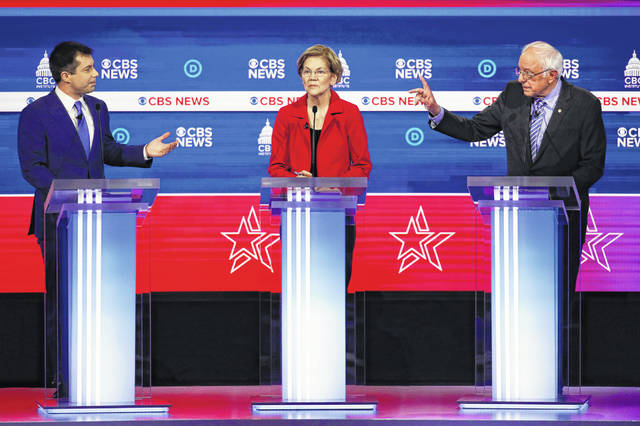 From left, Democratic presidential candidates, former South Bend Mayor Pete Buttigieg, Sen. Elizabeth Warren, D-Mass., and Sen. Bernie Sanders, I-Vt., participate in a Democratic presidential primary debate at the Gaillard Center, Tuesday, Feb. 25, 2020, in Charleston, S.C., co-hosted by CBS News and the Congressional Black Caucus Institute.