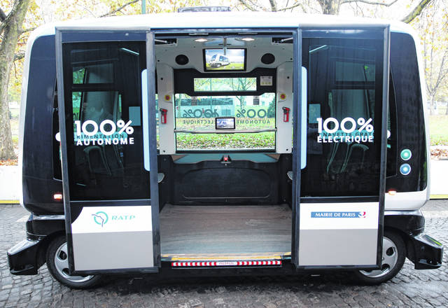 FILE - This Nov. 17, 2017, file photo shows a view inside an electric driverless shuttle produced by EasyMile, during an experiment, in Paris. The U.S. government's highway safety agency has ordered an autonomous shuttle company to stop carrying passengers in 16 U.S. cities after a mysterious braking problem occurred in Columbus, Ohio. The National Highway Traffic Safety Administration says the suspension will remain in place while it examines safety issues with the low-speed shuttles operated by France-based EasyMile.