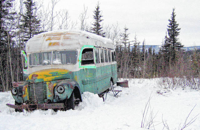 FILE - This March 21, 2006, file photo, shows the abandoned bus where Christopher McCandless starved to death in 1992 on Stampede Road near Healy, Alaska. For more than a quarter-century, the old bus abandoned in Alaska's punishing wilderness has drawn adventurers seeking to retrace the steps of a young idealist who met a tragic death in the derelict vehicle. Scores of travelers following his journey along the Stampede Trail have been rescued and others have died in the harsh back-country terrain. Now families of some of those who died are proposing looking at building a footbridge over the Teklanika River.