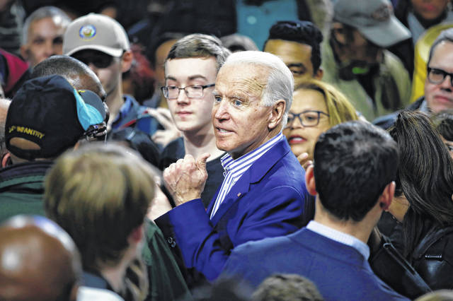 Democratic presidential candidate former Vice President Joe Biden meets with attendees during a campaign event, Friday, Feb. 28, 2020, in Spartanburg, S.C.