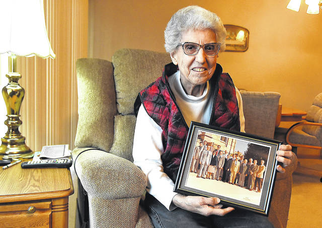"""Alberta Lee became Allen County's first female commissioner in 1990. She holds a photograph from that time, where she was the only female office-holder at the courthouse. The key, she said, was preparation. """"Just because you're a lady, you're not going to particularly get in. You've got to have some type of background,"""" she said."""