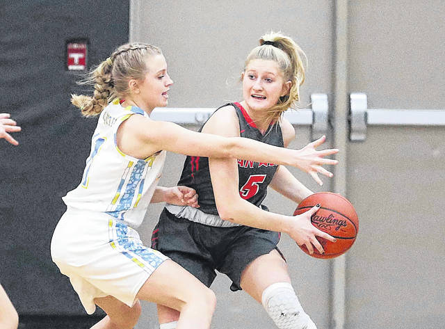 Bath's Alexandria Renner guards Van Wert's Kyra Welch during a Division II sectional final Saturday at Spencerville.