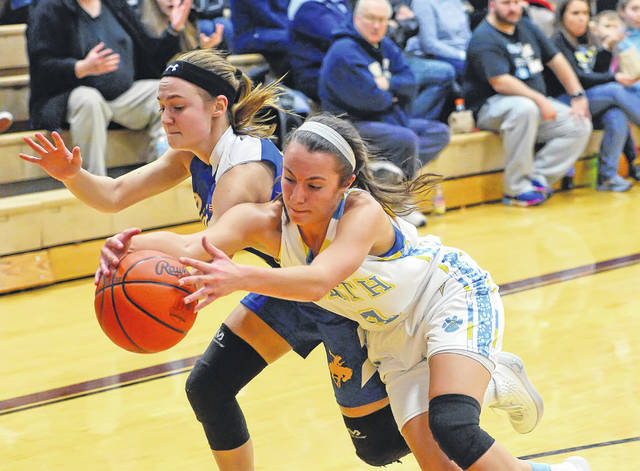 St. Marys' Ally Will, left, and Bath's Abbie Dackin compete for a loose ball during a Thursday night Division II district semifinal at Paulding.