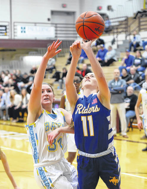 St. Marys' Kendall Dieringer puts up a shot against Bath's Madelyn Renner during a Thursday night Division II district semifinal at Paulding.