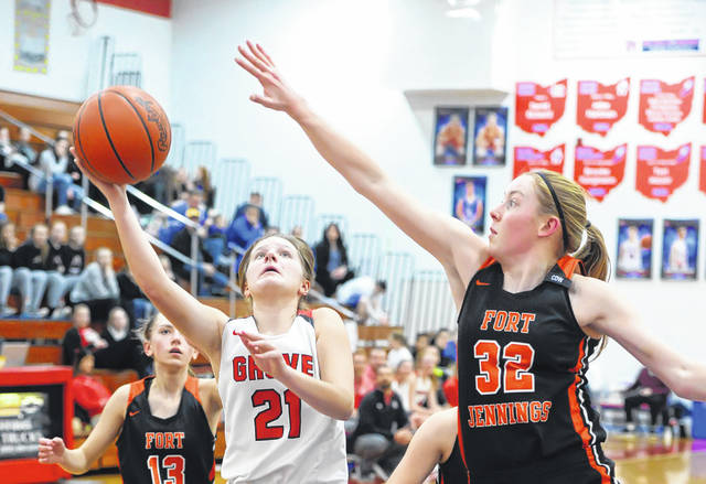 Columbus Grove's Kenzie King puts up a shot against Fort Jennings' Kristen Luersman during a Thursday night Division IV sectional final at Patrick Henry.