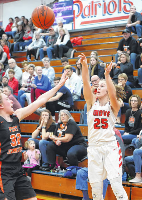 Columbus Grove's Savanah Ridenour puts up a shot against Fort Jennings' Kristen Luersman during a Thursday night Division IV sectional final at Patrick Henry.