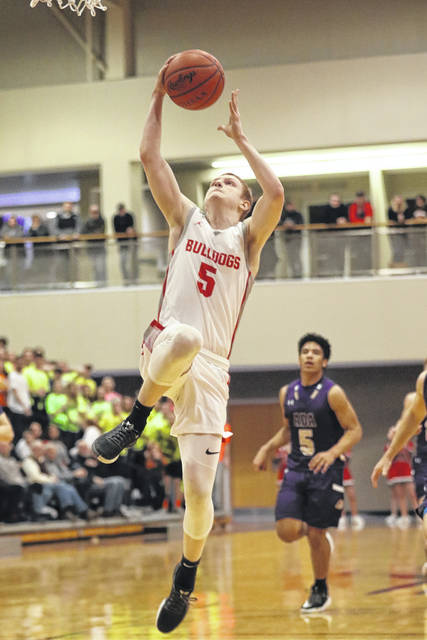Columbus Grove's Gabe Clement goes up for a shot during a Friday night Division IV sectional final against Ada at Bluffton University.  Amanda Wilson | The Lima News