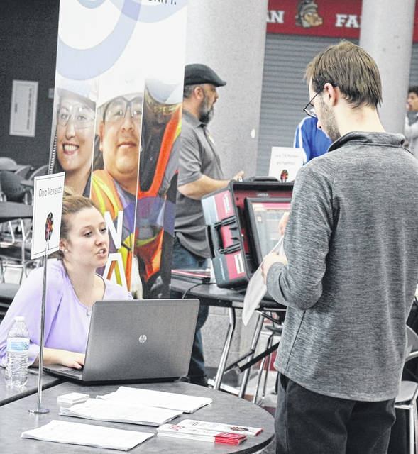 Austin Long (right), a Lima Senior student, speaks with Alexus Miller-Schmenk, a career consultant with Ohio Means Jobs.