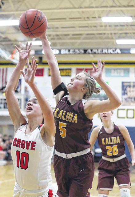 Kalida's Grace Klausing defends a shot by Columbus Grove's Erin Downing during Saturday night's Division IV district final at Ottawa-Glandorf.