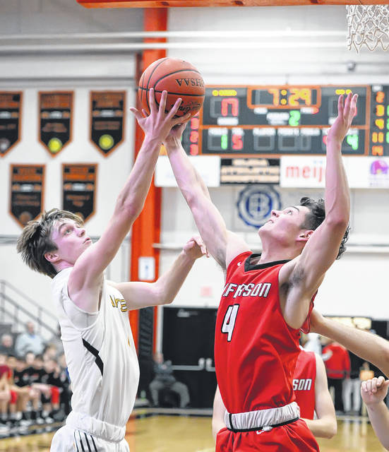Delphos Jefferson's Ian Wannamacher, right, battles Fairview's Caleb Frank for a rebound during a Tuesday night Division III sectional semifinal at the Elida Fieldhouse.