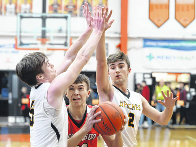 Fairview's Caleb Frank, left, and Cade Polter defend Delphos Jefferson's Levi Rode during a Tuesday night Division III sectional semifinal at the Elida Fieldhouse.
