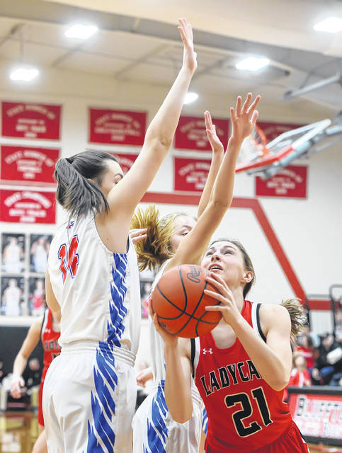 Delphos Jefferson's Josie McGue looks to shoot against Liberty-Benton during a Saturday Division III sectional final at Bluffton High School.