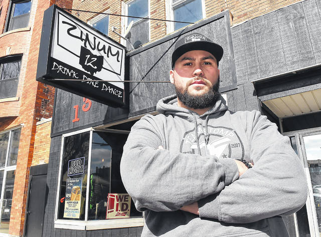Devin Muniz, owner of Zinum 12 on High Street in Lima. Craig J. Orosz | The Lima News