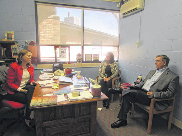 From left are Stephanie Williams, Lima Central Catholic High School principal and CEO, and Donna Judy, St. Rose Catholic School principal speaking with Ohio Rep. Bob Cupp.