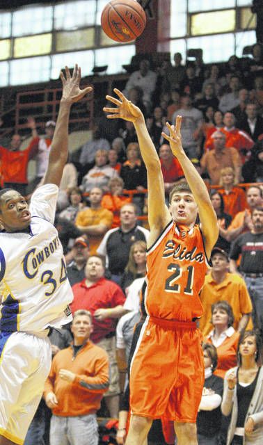 Elida's Reggie McAdams lets go of what proved to be the basket that gave the Bulldogs a 50-47 overtime victory against Toledo Libbey in the Division II district final at Bowling Green State University in 2009.