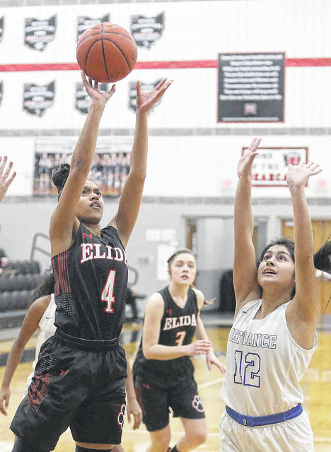Elida's Amira Freeman puts up a shot against Defiance's Tammy Aguilera (12) during a Tuesday night Division ll sectional semifinal at Spencerville.
