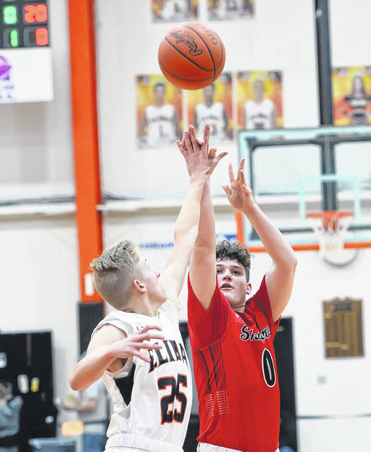 Shawnee's John Barker puts up a shot against Elida's Riley Fricke during Friday night's game at the Elida Fieldhouse.