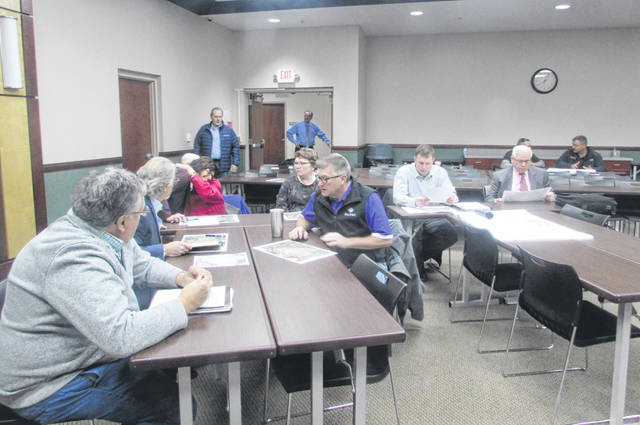 Putnam County government officials, engineers and contractors met for a meeting to discuss a diversion channel project to help alleviate flooding in Ottawa.