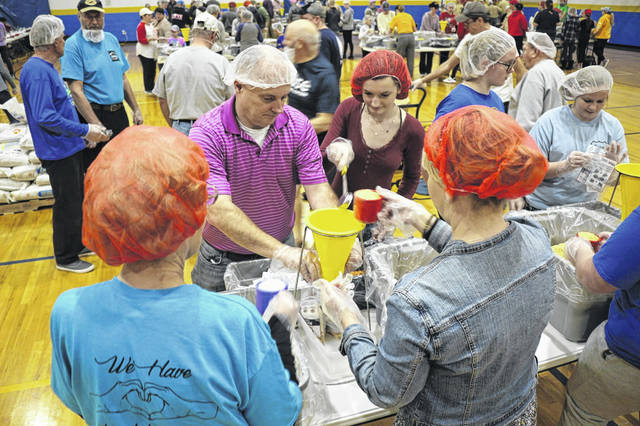 Volunteers helped pack food packets in the Rise Against Hunger event Sunday at Delphos St. John's High School.
